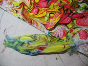 Paper Marbling Technique Used on Parrot Feathers
