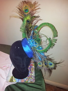 Peacock feather silk pillbox hat in teal.