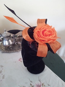 Vintage lace fascinator with silk abaca bow in orange and black.