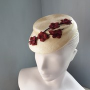 Small straw cap with leather branch and flowers
