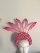 Dramatic pink crown with floating feathers