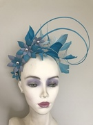Powder blue and teal leather and feather crown