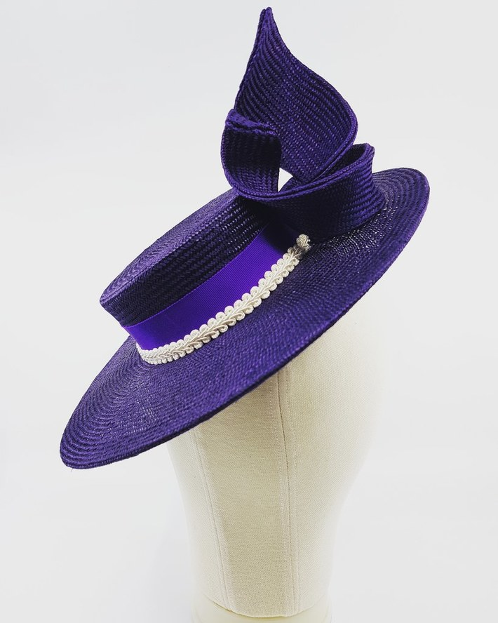 Purple straw boater with matching trim and ribbons