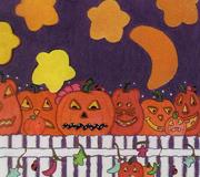 Scary Pumpkins on a Fence