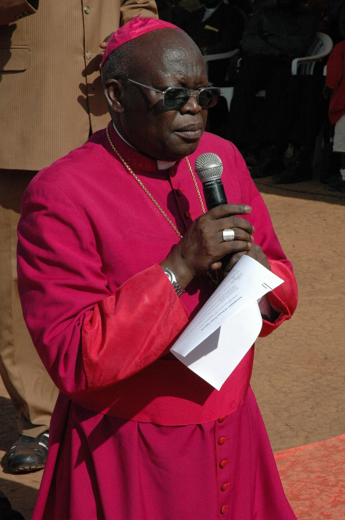 Archbishop Odama kneeling