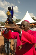 Odama holds up his trophy for the Peacemaker Prize