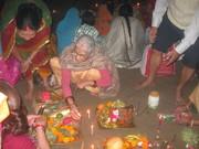 Preparations at Sangam (Arail) ghat for morning arghya