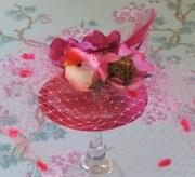 fuchsia pink bird cocktail hat.
