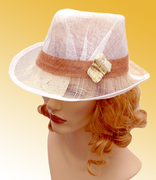 Light summer woman hat with a brim, sinamay with porcelain brooch