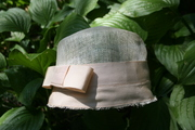 Sinamay cloche with beige petersham ribbon
