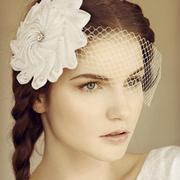 Origami inspired veil bridal hat