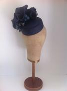 Navy parabuntal recessed cocktail button with freeform wave & handcut petals by Murley & Co Millinery