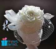 Bridal fascinator with a large silk rose