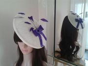 Ivory saucer hatinator with purple bow and feathers