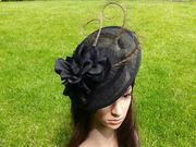 Black saucer with satin flower and 3 curled feathers