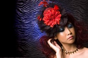 Black pleated organza fascinator with red flower