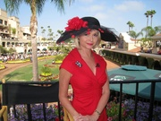 Black hat with red trim by Diana Cavagnaro Couture Millinery