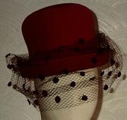Pink velvet hat with large spot veiling