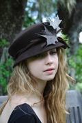 brown wool-felt hat with felt leaves