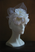 whtie bridal felt fascinator with flowers and veiling