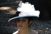 big dark navy blue derby straw hat