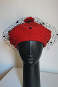 Red beret with veiling by Anastasia Frei