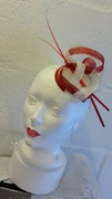 sinamay button fascinator with stripped feathers