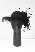 Felt hat with feathers by Anastasia Frei