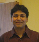 Dr. Aanand Kambli (AM)