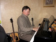 Bruce playing piano at a home session
