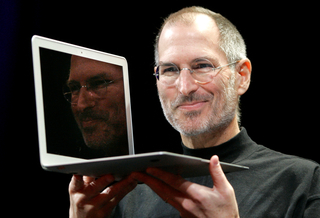 In this Jan. 15, 2008, file photo, Apple CEO Steve Jobs holds up the new MacBook Air after giving the keynote address at the Apple MacWorld Conference in San Francisco. Apple on Wednesday, Oct. 5, 2011 said Jobs has died. He was 56. (AP Photo - Jeff Chiu, File)