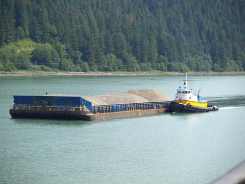 Barge and tug approaching Juneau in Gastineau Channel