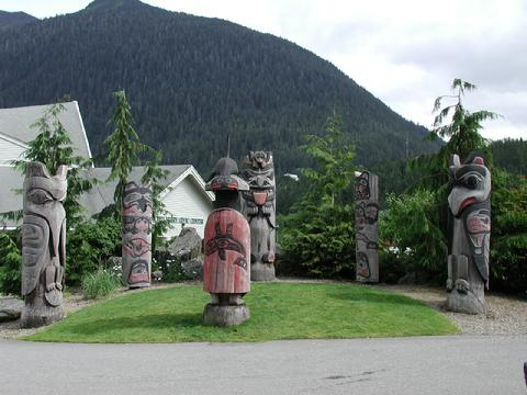 Totems behind Cape Fox Lodge