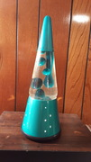 teal wizzard with teal lava bottle