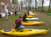 Students get instructions how to get in a kayak- rev