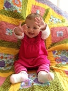 My granddaughter Gwen with her quilt