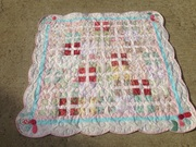 Pastel Prints baby girl quilt with appliques and scalloped border