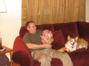 Staying close while Papaw holds Kirby.