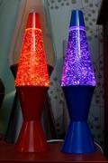 Red and blue glitter globes on Elek-Trick bases