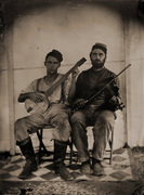 Clifton (left) and his fiddle playing friend Lars
