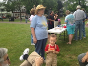 grandparents relaxed with their toddler-grandson in Chatham Square Park.