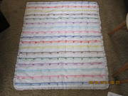 Baby quilt out of eyelet fabric & ribbons