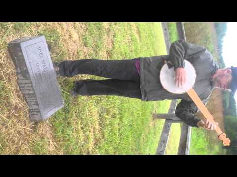 Joe Ayers playing banjo at Joe Sweeney's grave