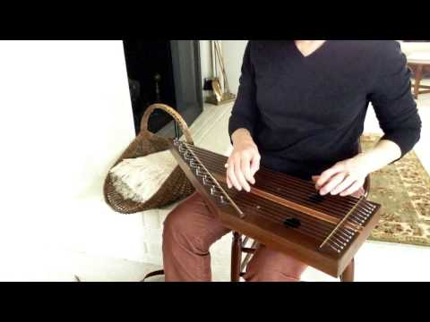Music box tune on a lap harp or plucked psaltery