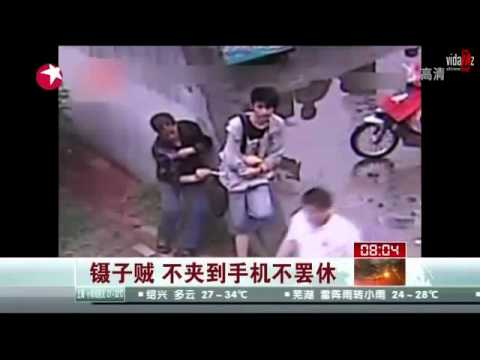 Chinese pickpocket uses Chopsticks to steal cell phone