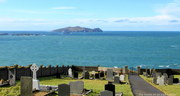 The graveyard at Dún Chaoin, looking out at An Fear Marbh, one of the Blasket Islands.