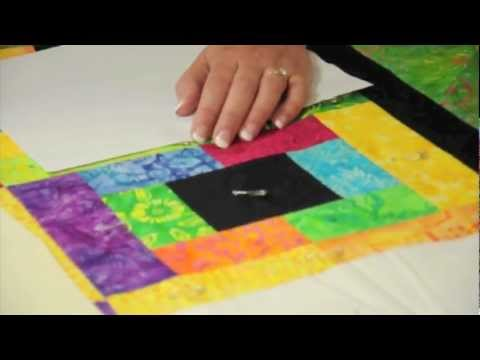 Learn How to Sandwich a Large Quilt on a Small Table - Amélie Scott Designs