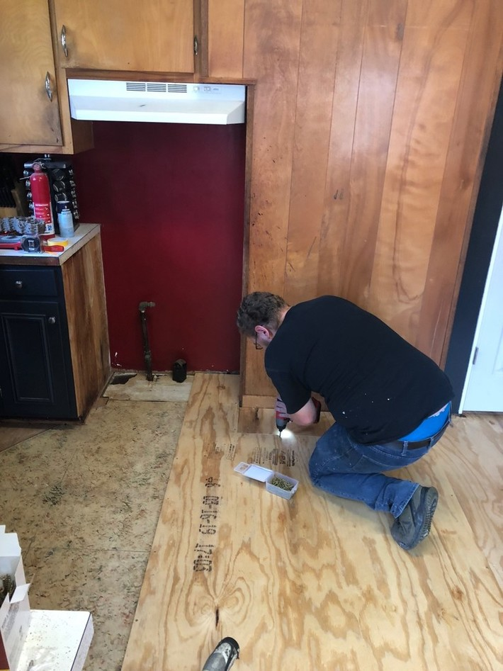 Kaleb helping screw down the new sub floor