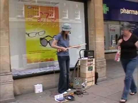 bemuzic goes busking, armed with a 3 string Cigar Box Guitar, Diddley Bow, Canjo and Loop pedal : -)