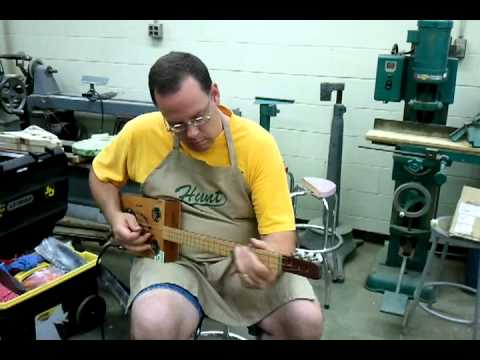 Rocking a Cigar Box Guitar.mp4